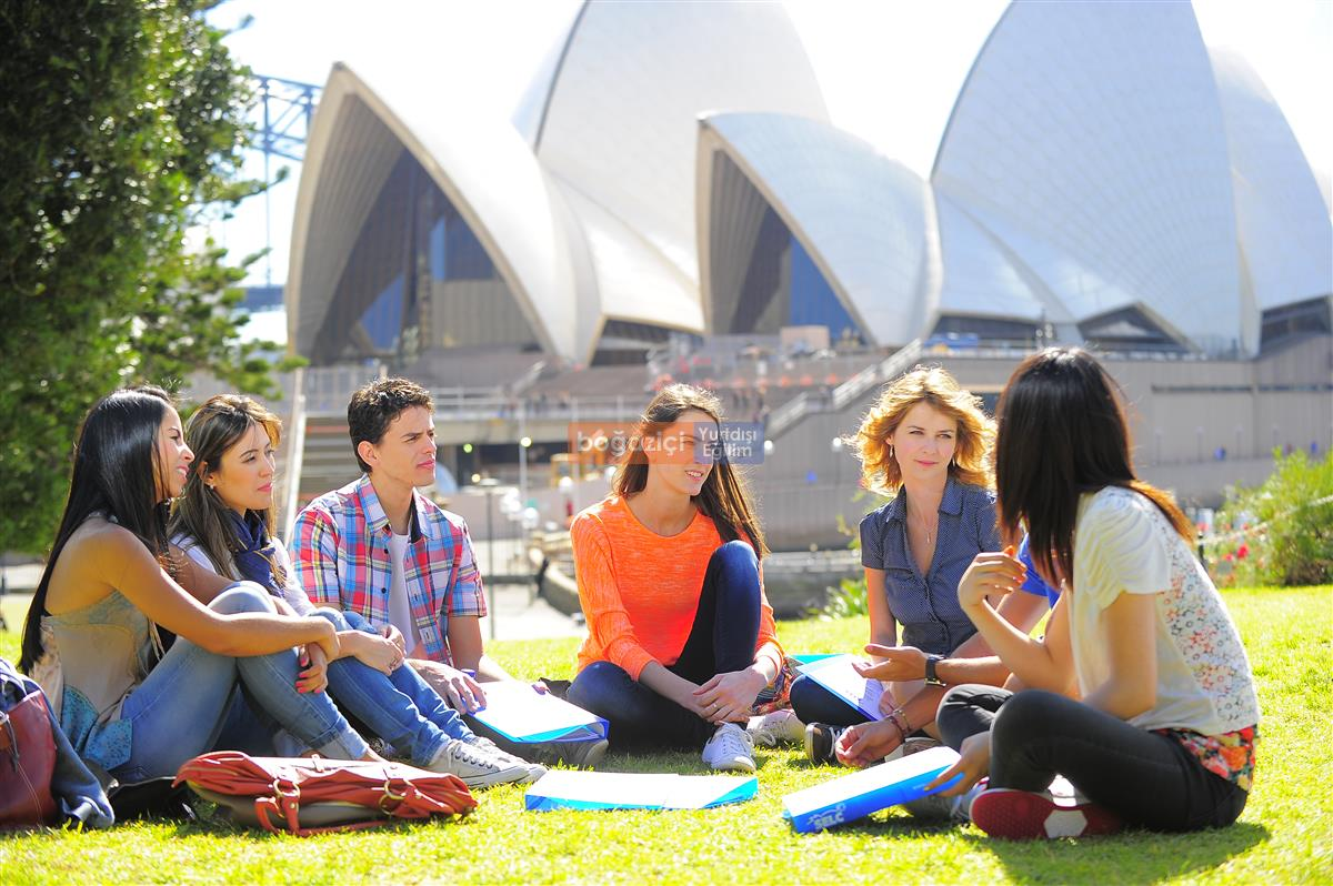 group with opera house behind